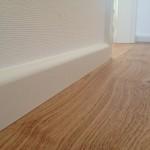 Parkett Holzboden und Sockelleisten